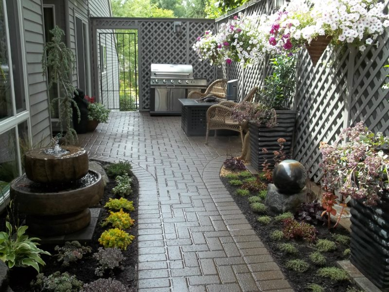 paver-patio-water-feature-plants-pots