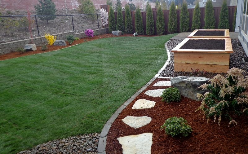 graden boxes-lawn-edging-plants-stepping stones