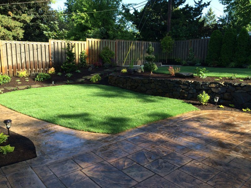 stamped concrete-patio-lawn-plants-backyard landscape