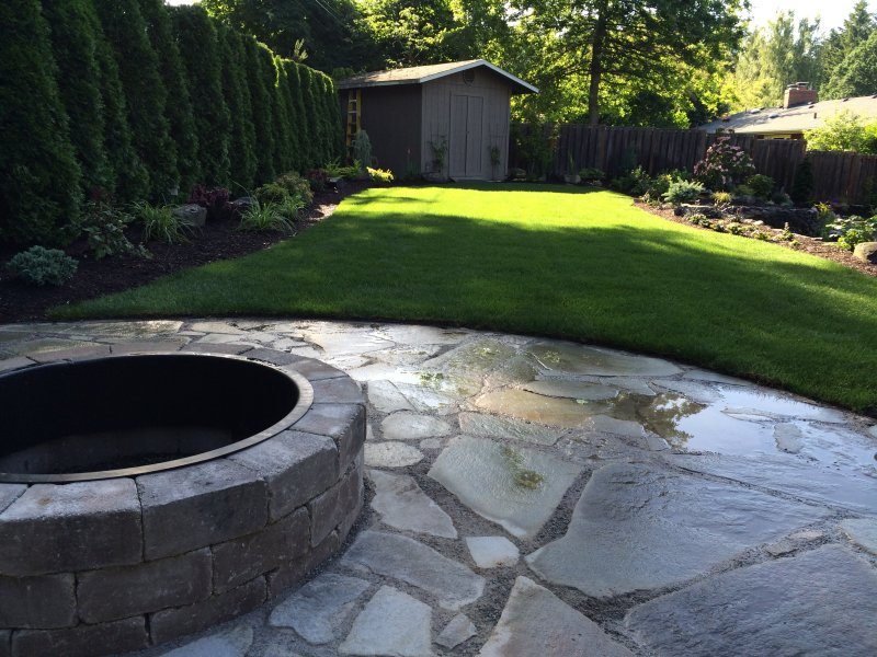 patio-flagstone-fire pit-lawn-plants-backyard design-design