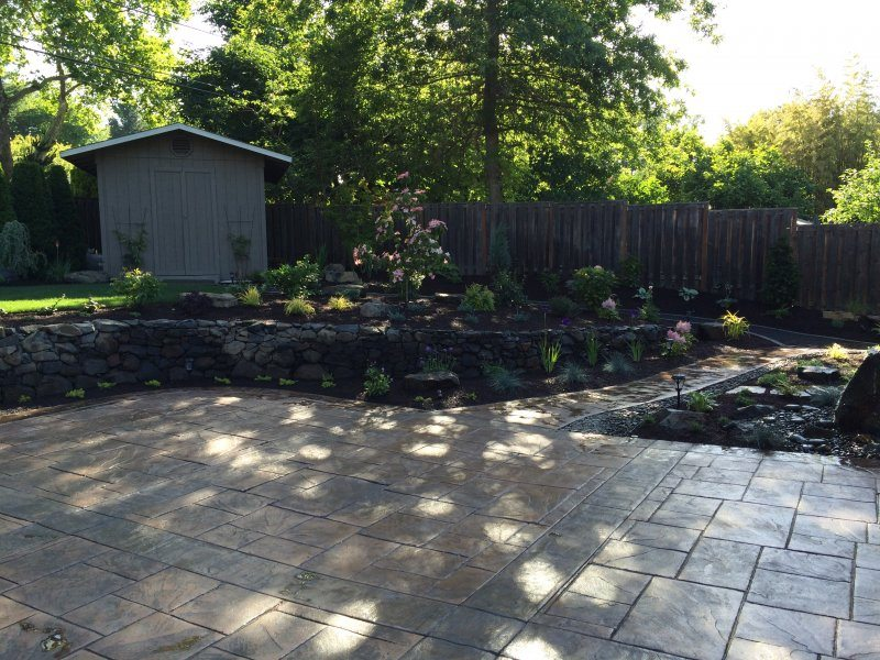 stamped concrete-patio-backyard design-rock wall-wall-